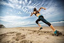 Running woman, female runner jogging during outdoor workout on